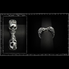 Two skull tudor ring