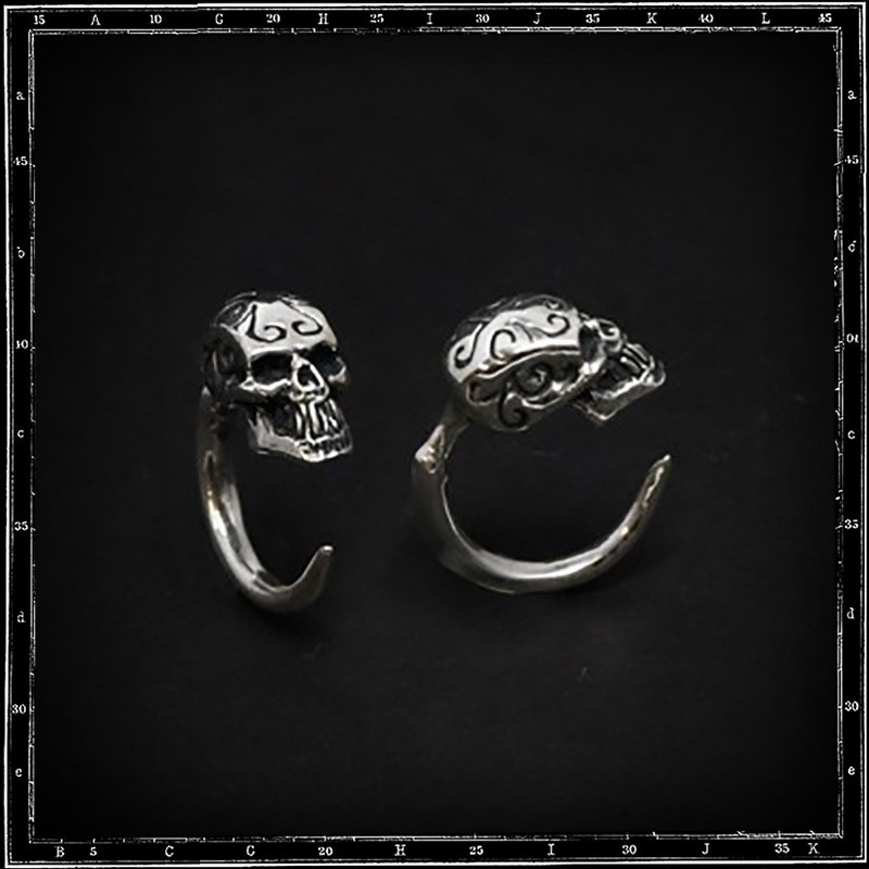 Tribal skull hoop earring