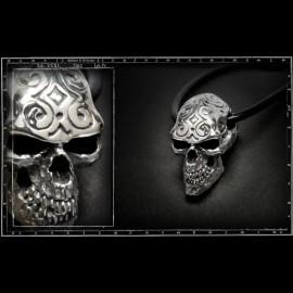 Engraved skull pendant