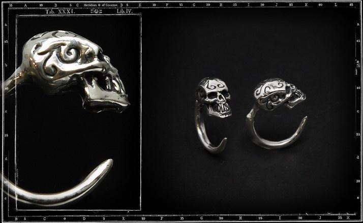 Tribal skull hoop earring